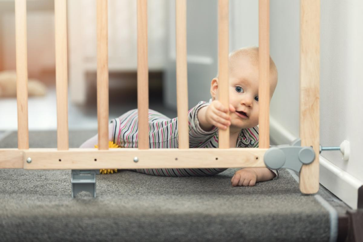 Child Safety Week - picture of a child protected by a stairs safety gate